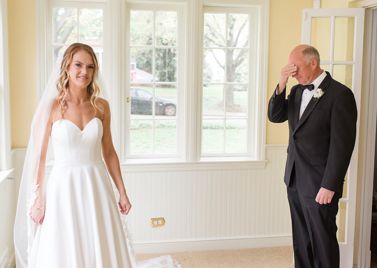 bride getting ready to do a first look with her dad