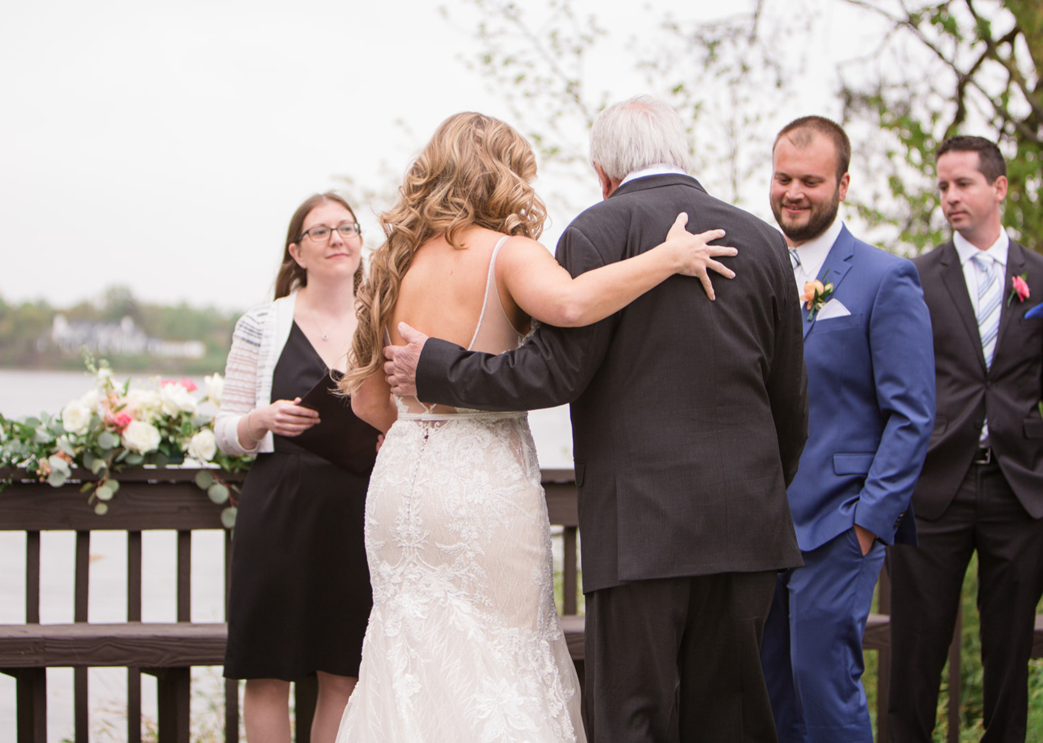 father giving bride away to the groom