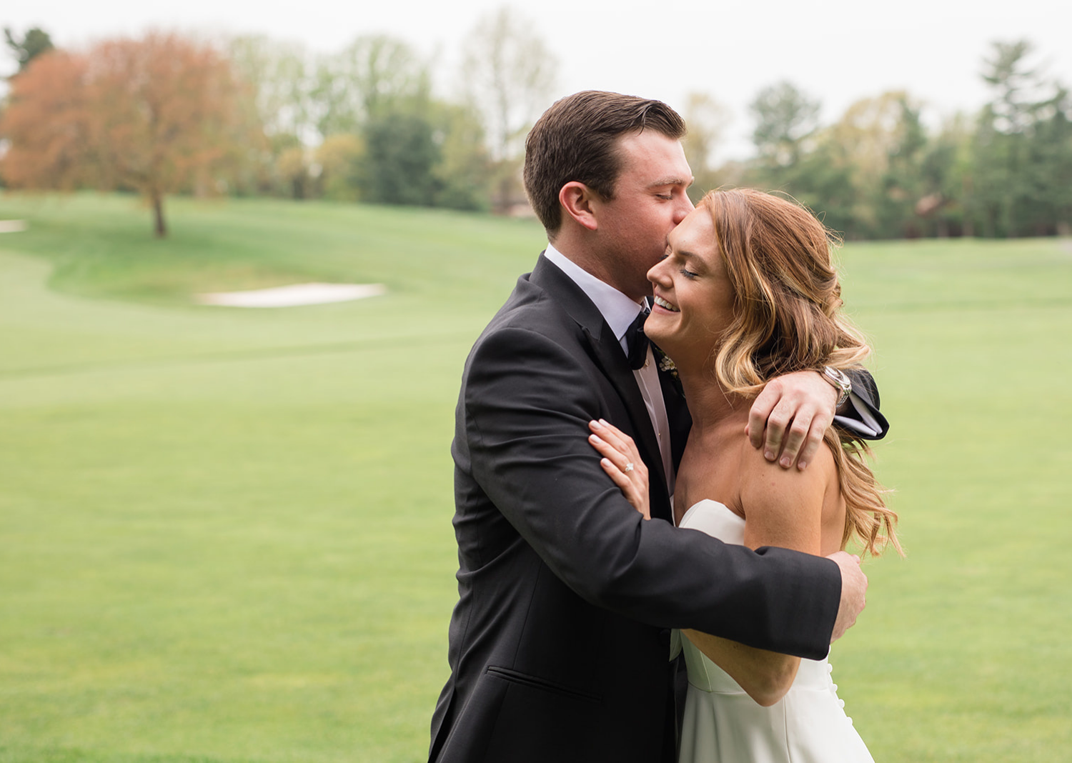 groom hugs his bride as he sees her for the first time in her wedding dress