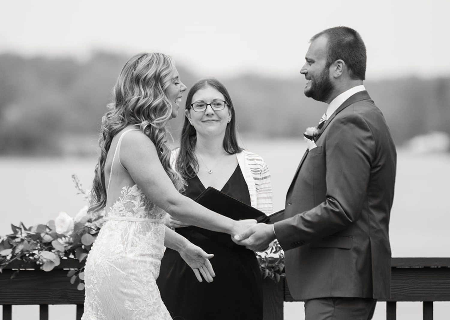 black and white photo of bride and groom during their wedding ceremony