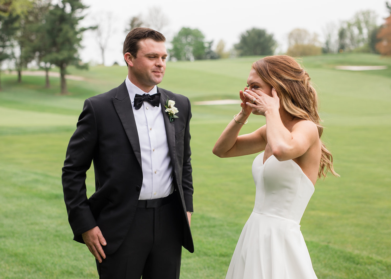 bride wipes away happy tears as she sees her groom