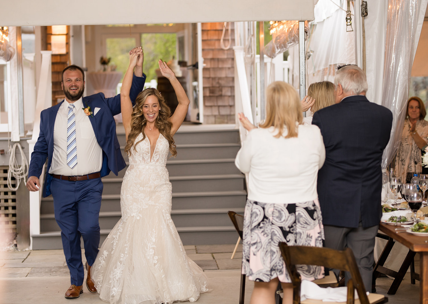 bride and groom make their first entrance to their wedding reception as husband and wife