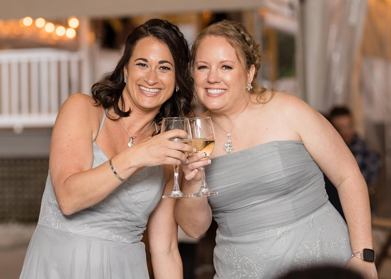 bridesmaids enjoying a drink during the wedding reception