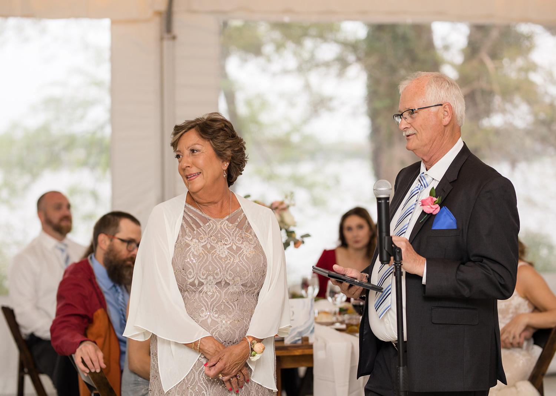 parents of the groom giving a wedding speech
