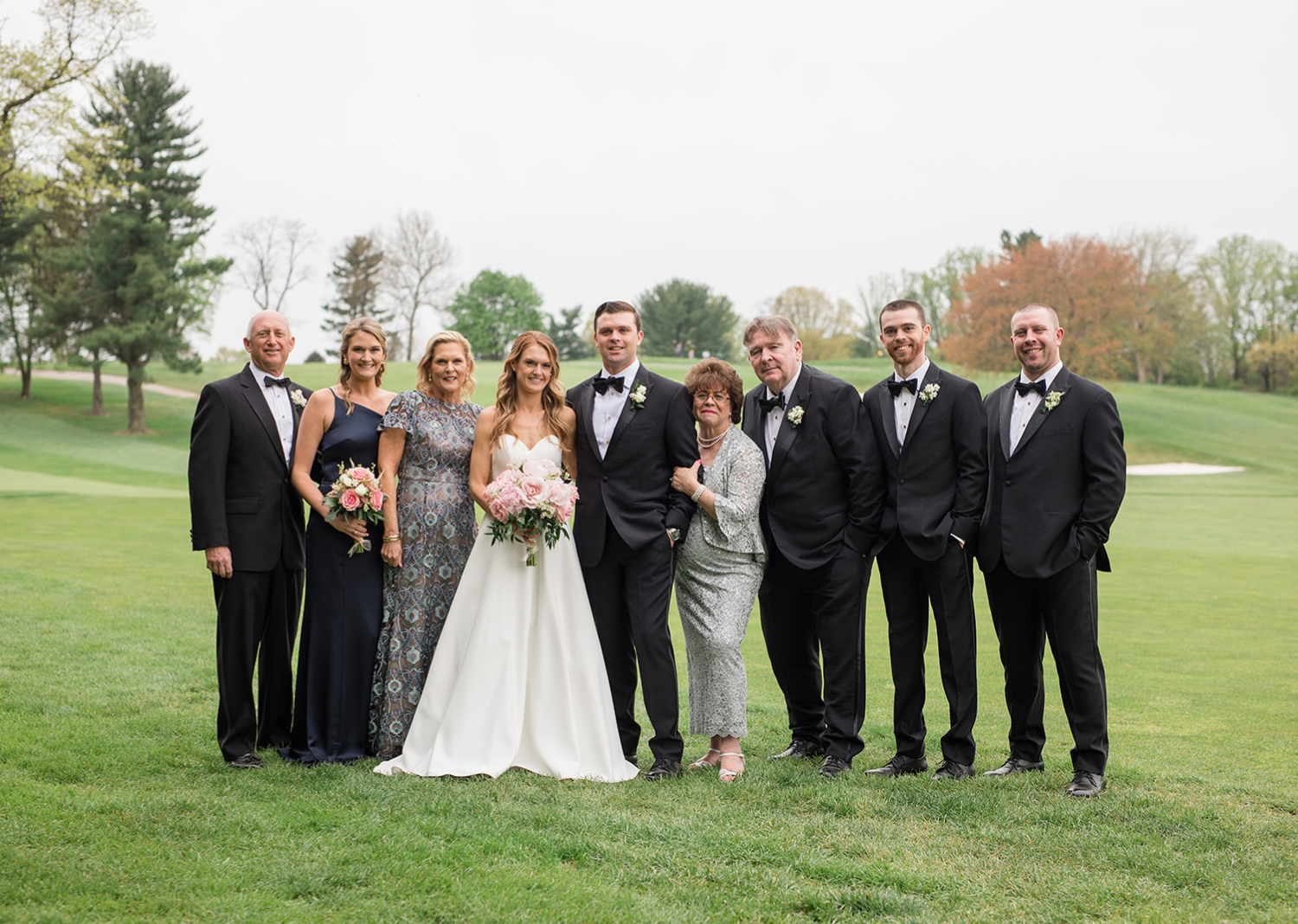 bride and groom with their family for family wedding portraits