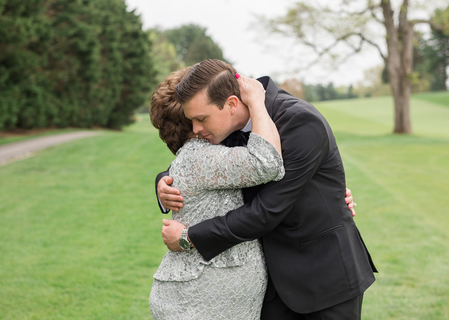 groom and mother of the groom sharing a hug