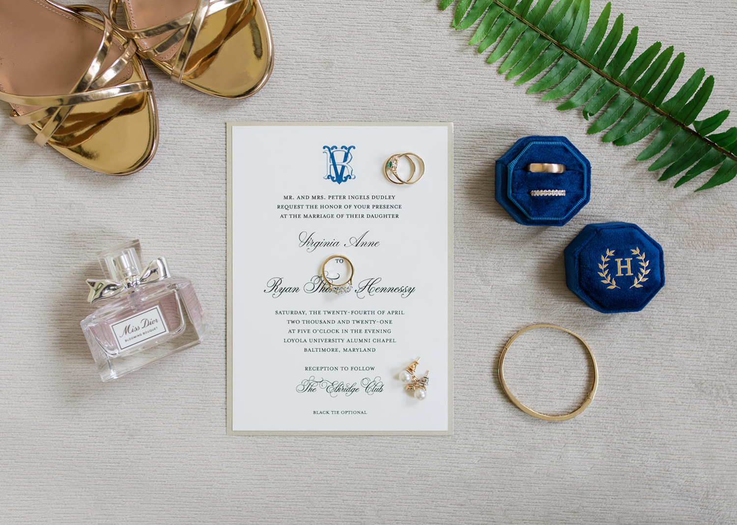 wedding day details and wedding rings on a flatlay