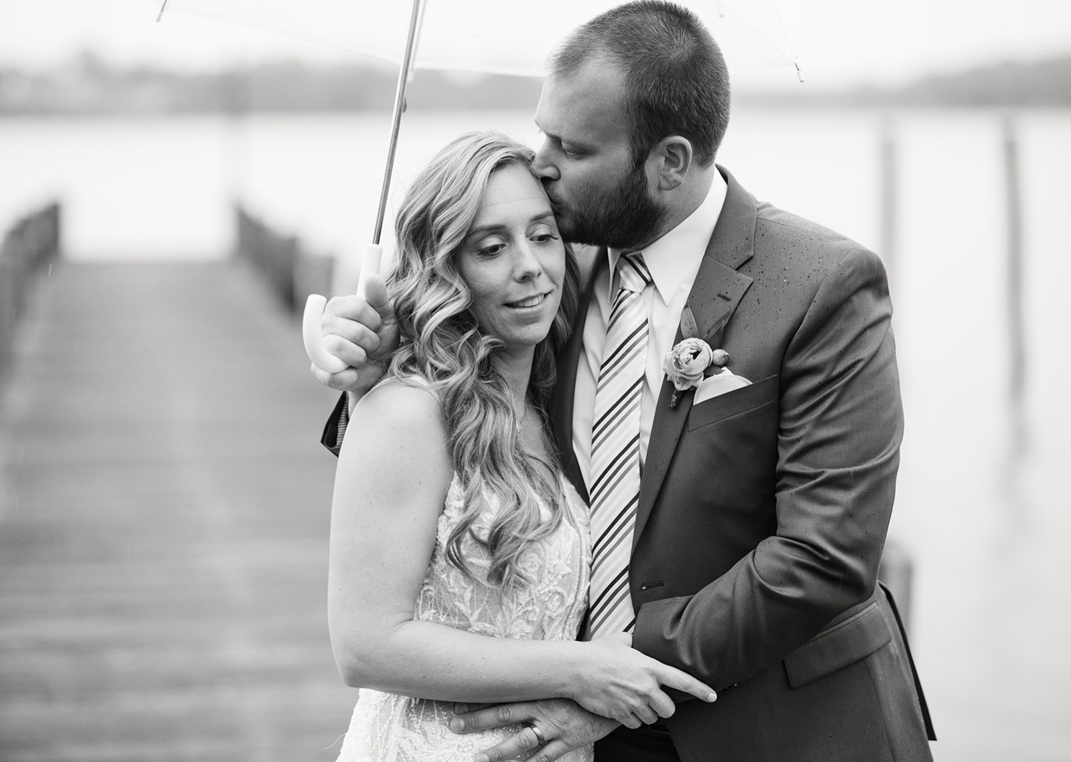 outdoor wedding portraits of the bride and the groom on a rainy deck