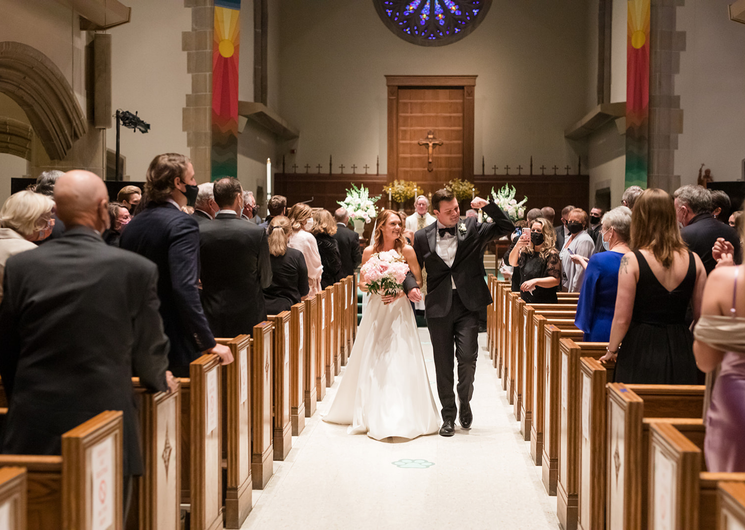 bride and groom walking down the aisle after their wedding ceremony