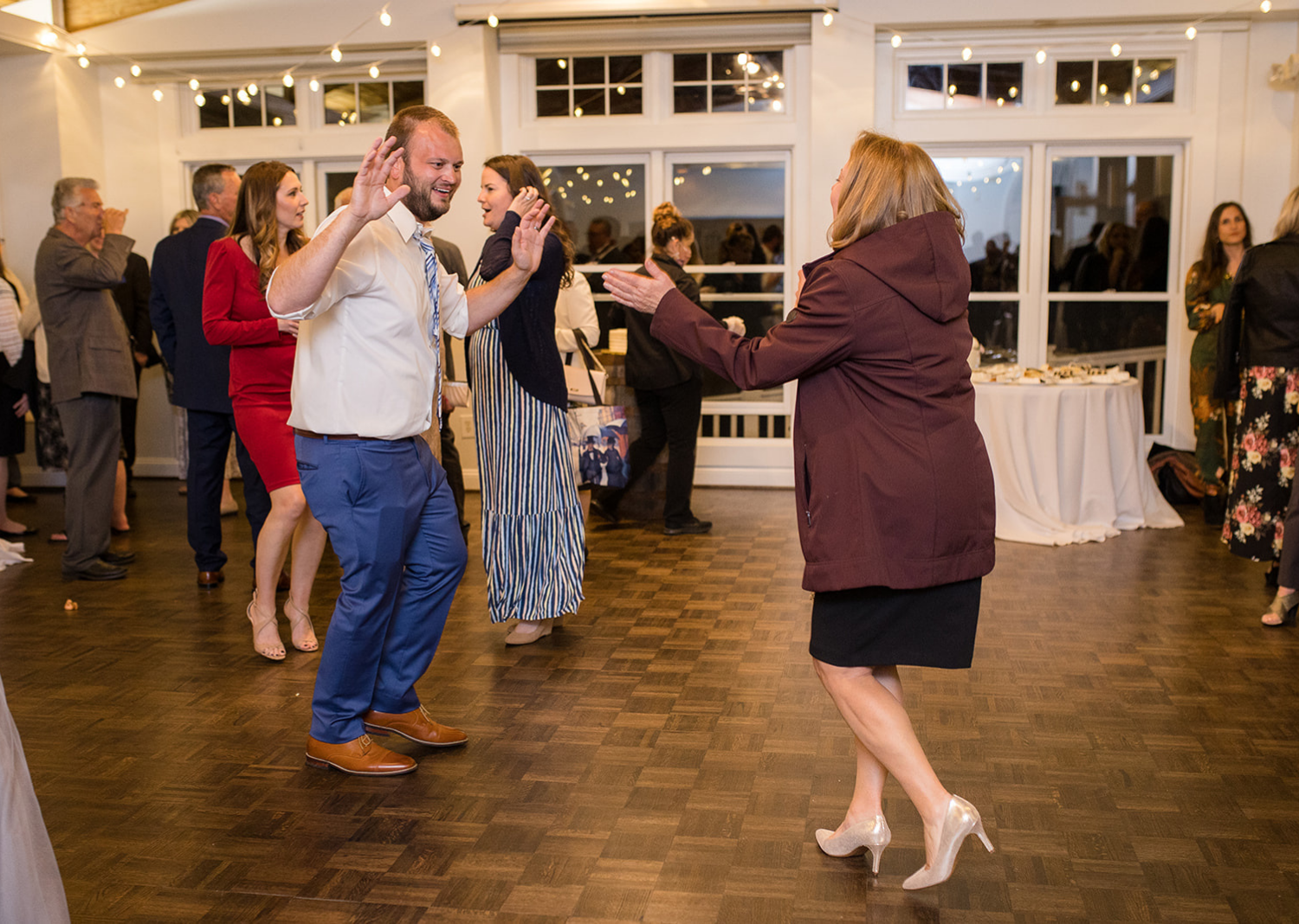 wedding guests dancing during the wedding reception