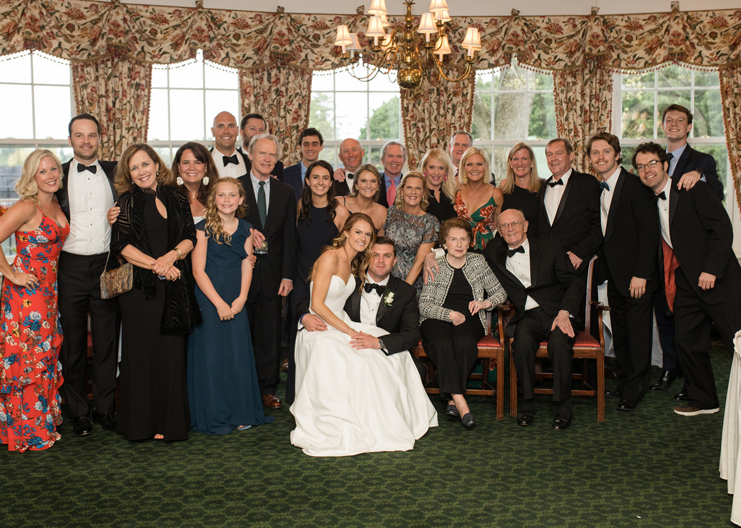 bride and groom with their family during the wedding reception