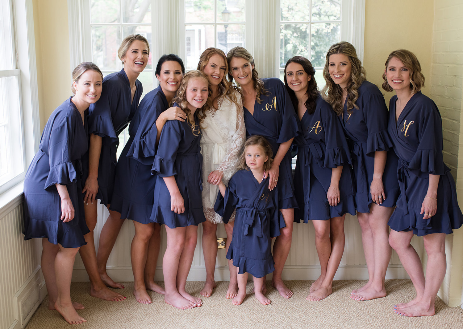 bridesmaids, flowergirl and mother of the bride with the bride getting ready