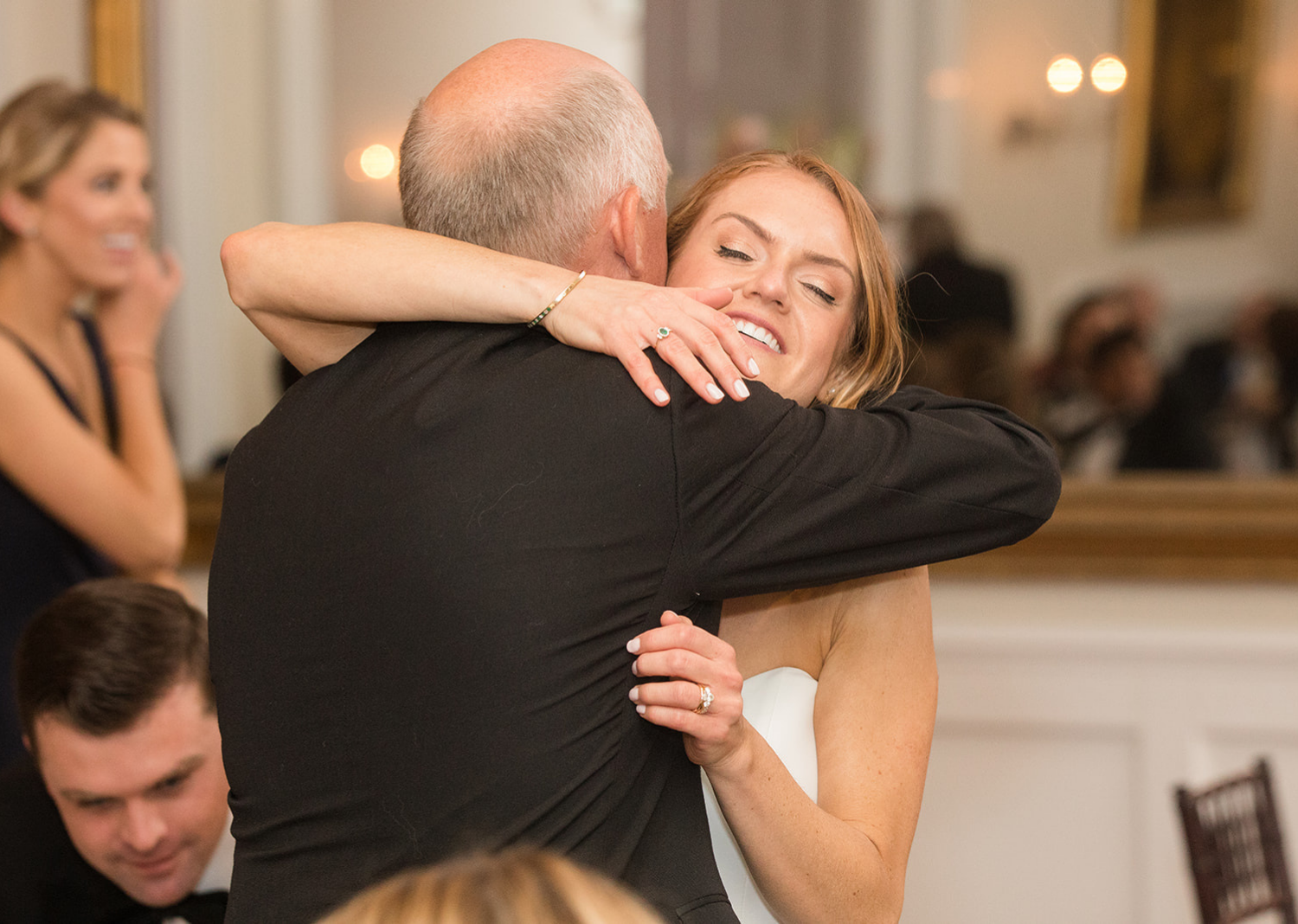 bride and her father share a hug