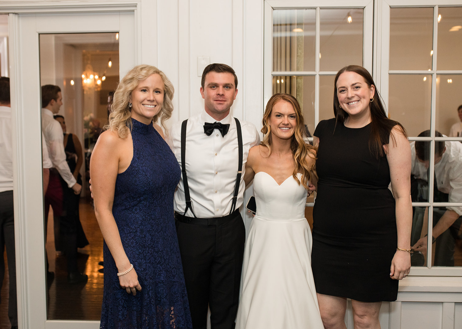 bride and groom with wedding guests