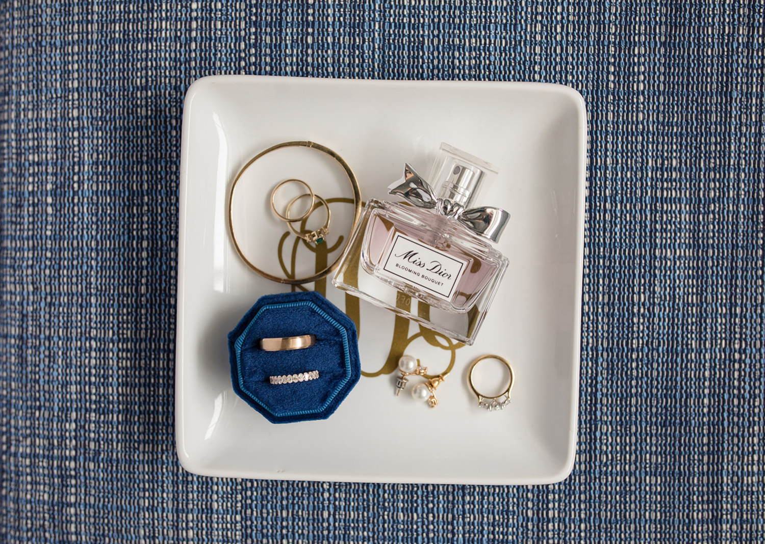 wedding rings and wedding accessories on a flat lay