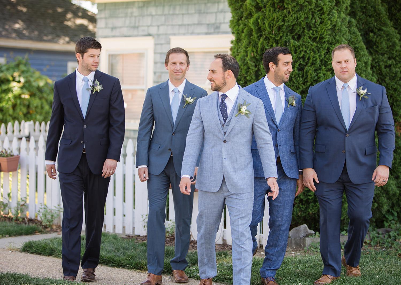 groom and groomsmen walking outside