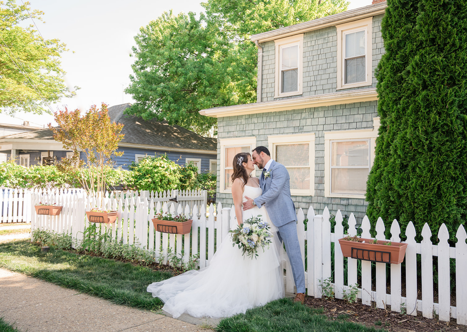 outdoor bride and groom portraits - bride and groom share a kiss