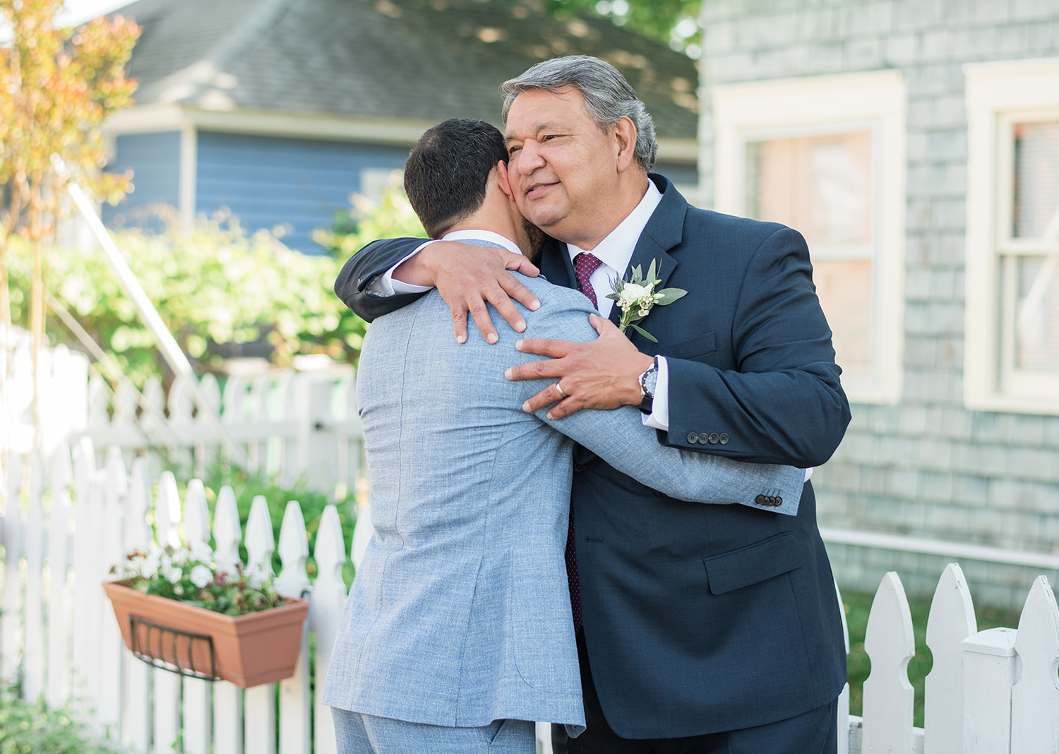 groom hugging his father on his wedding day