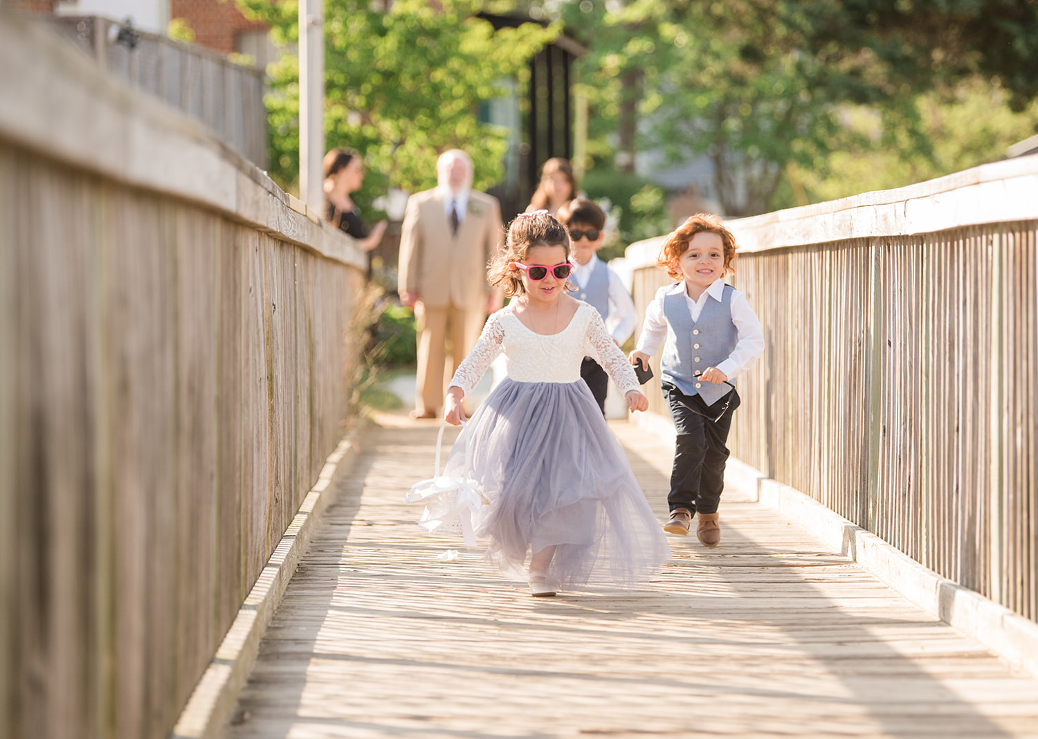 flower girl and ring boy walk down the aisle