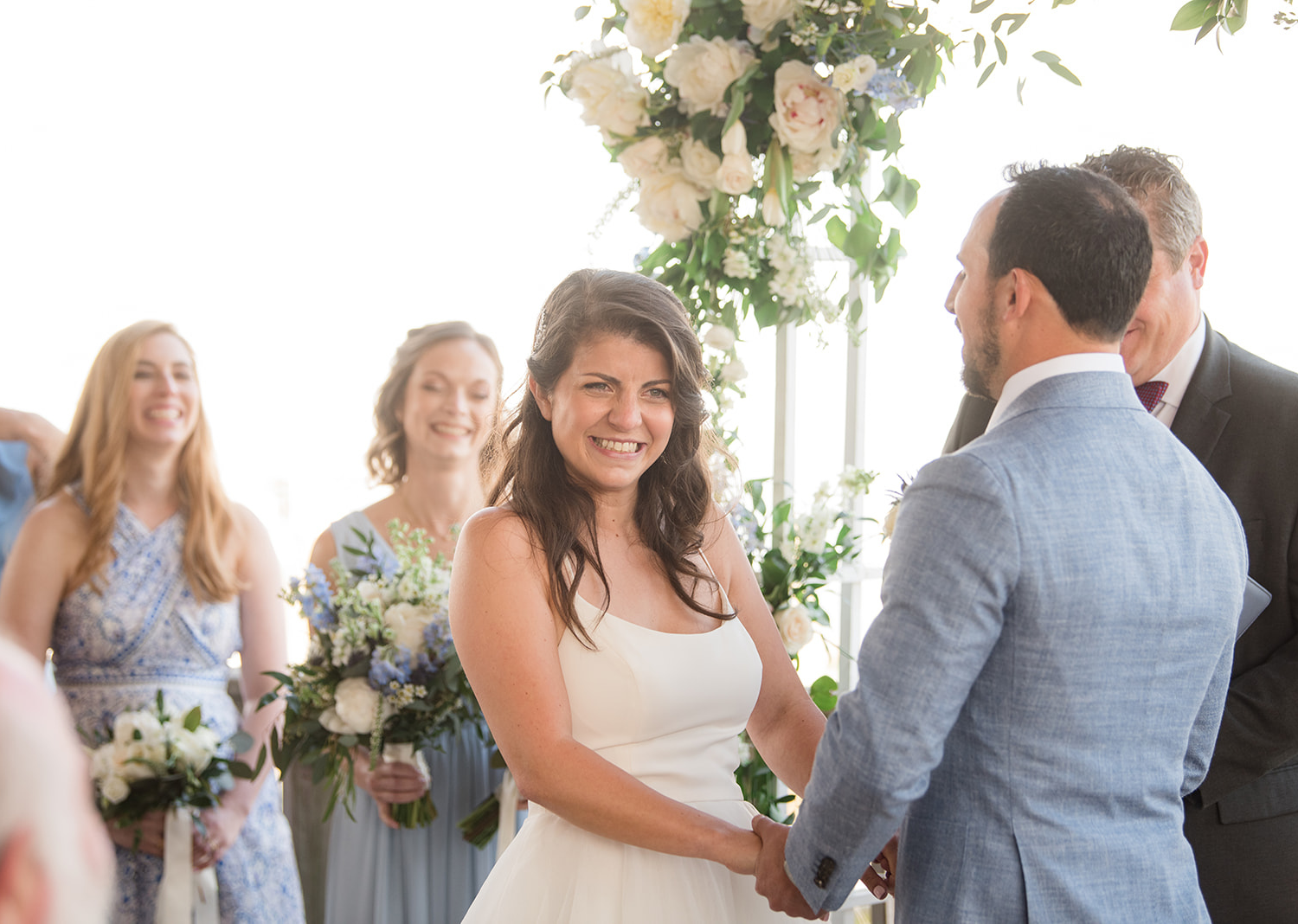 bride smiling as the ceremony begins