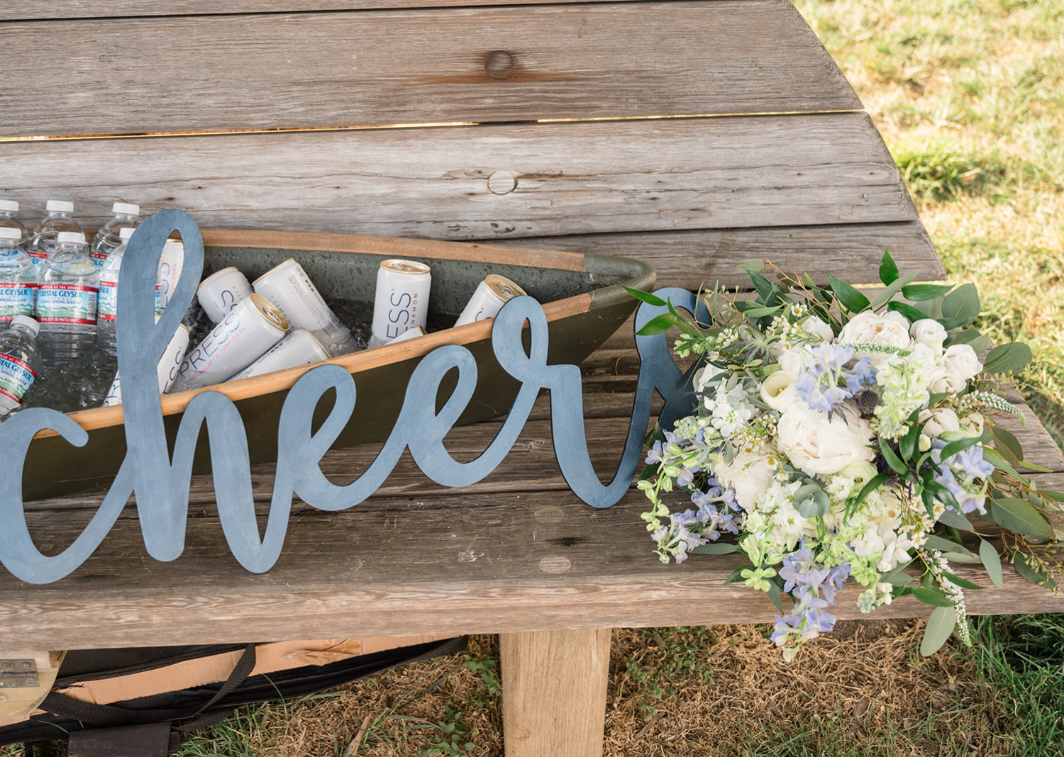 wedding details with a cheer sign around drinks