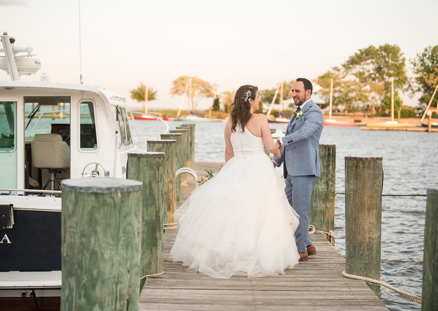 bride and groom sharing a romantic moment at the lake pier