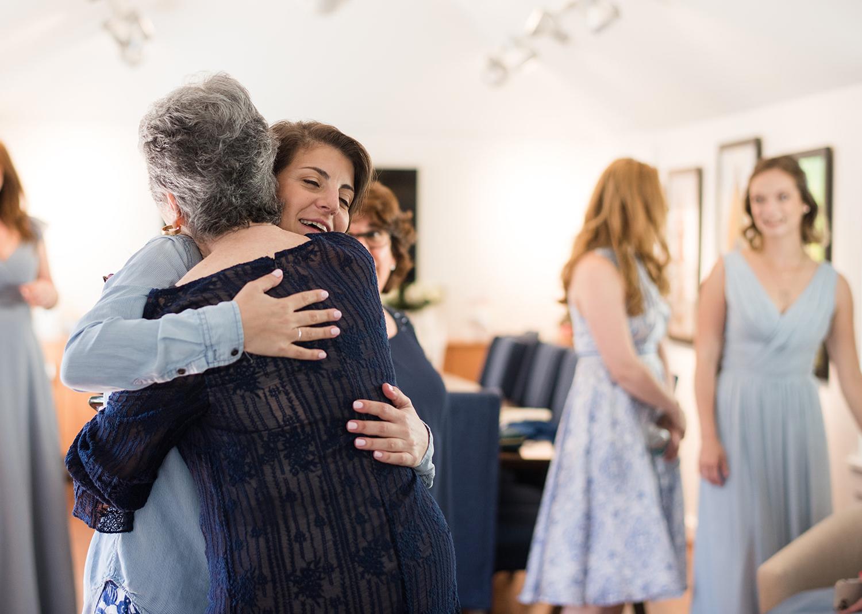 bride hugging her grandma as they get ready