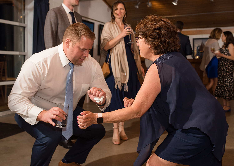 wedding guests dancing at the wedding reception