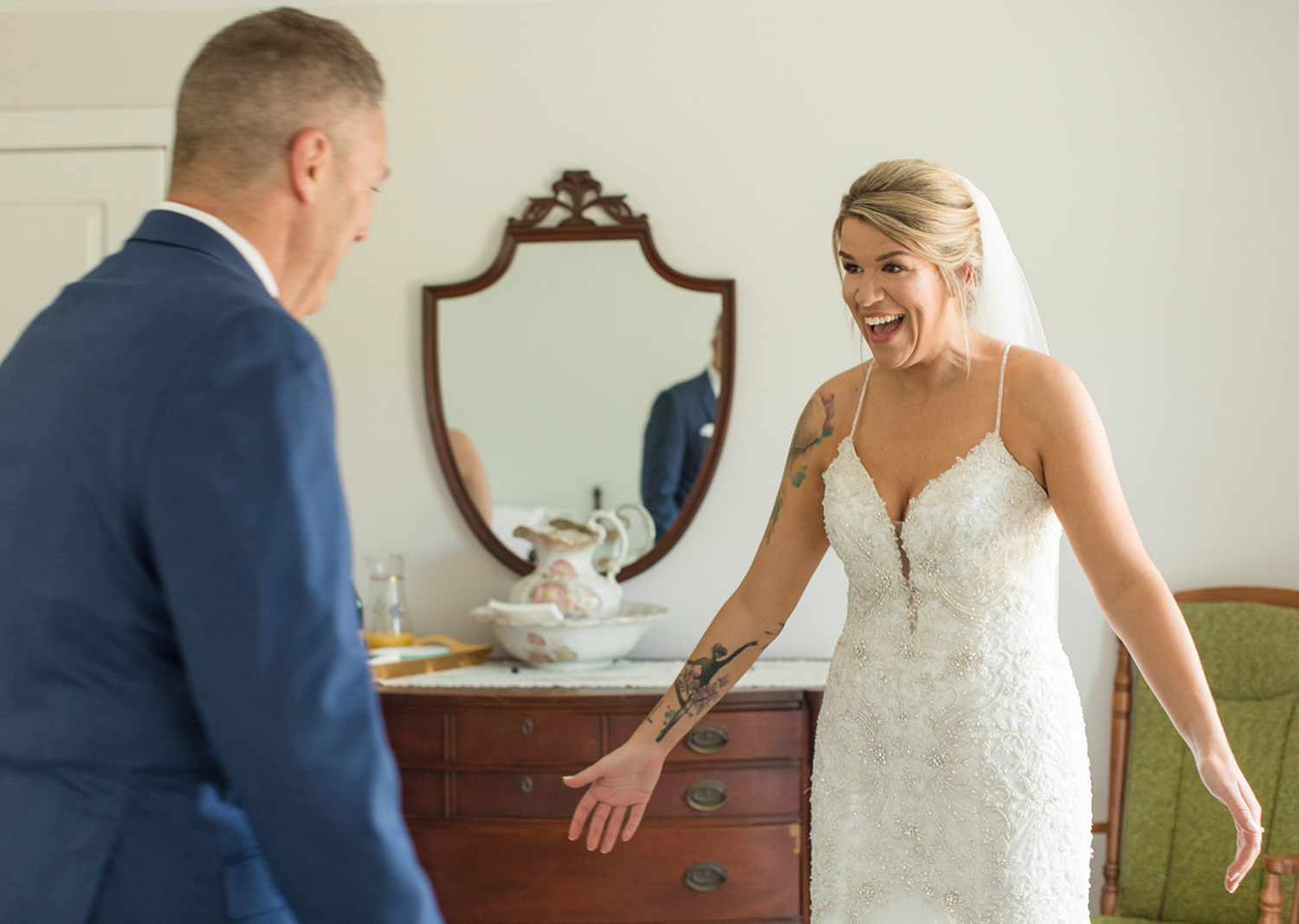 father of the bride sees his daughter in a wedding dress for the first time