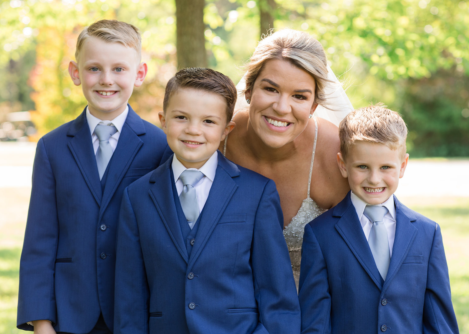 bride with her sons before the wedding ceremony