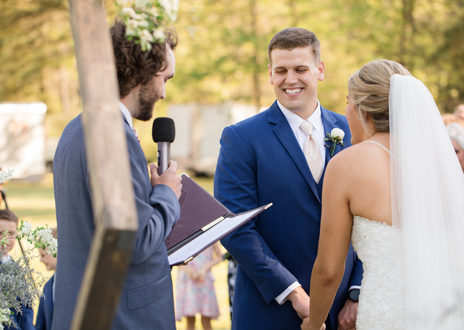 groom and bride smiling as they hear their wedding ceremony speech