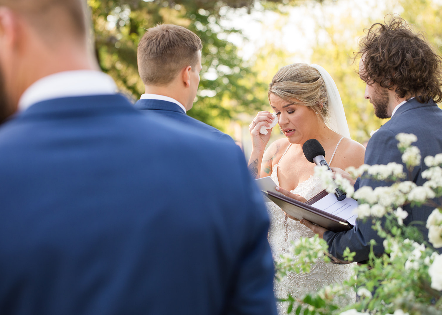 bride tears up as she reads her wedding vows