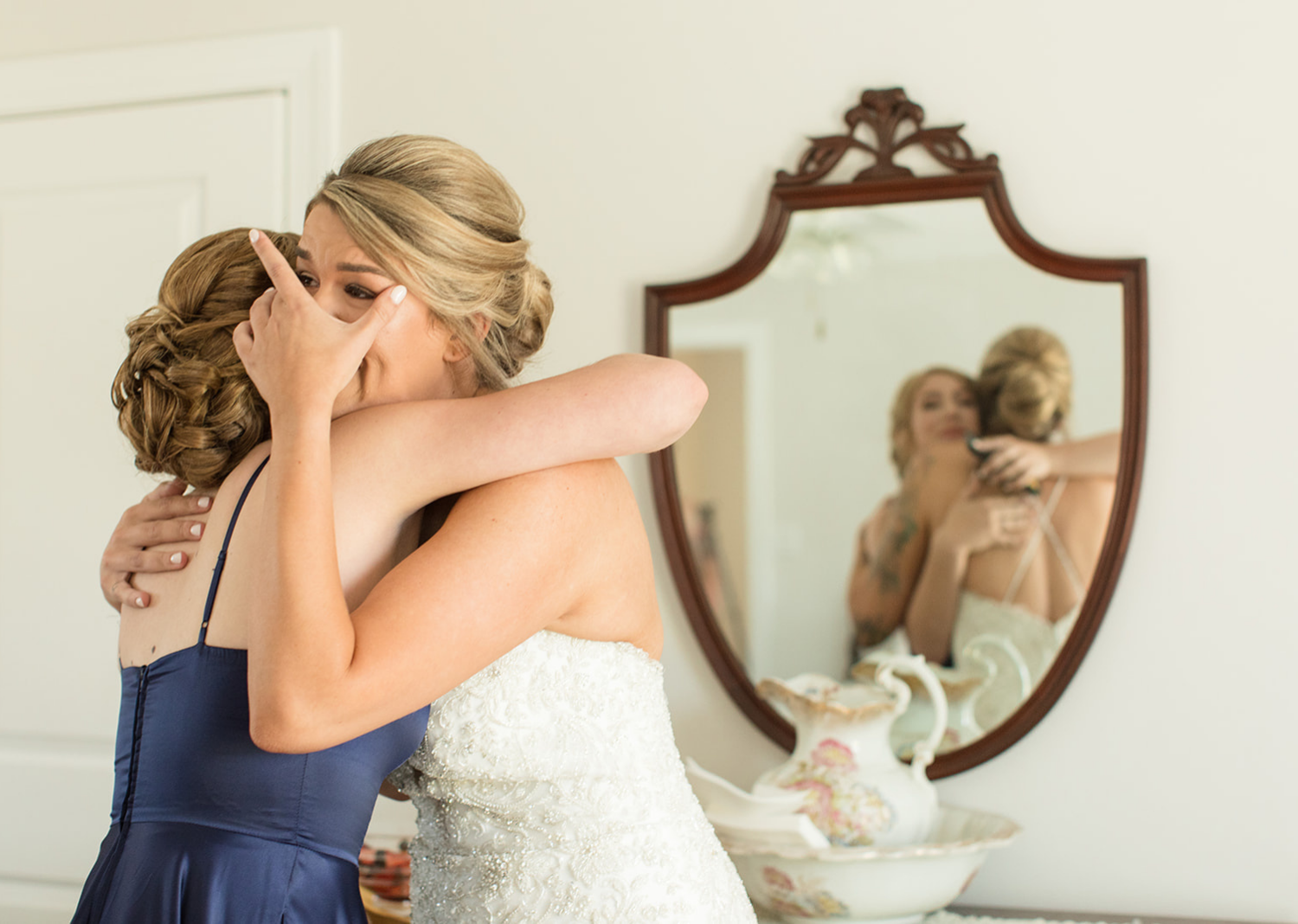 maid of honor crying as she hugs her mom