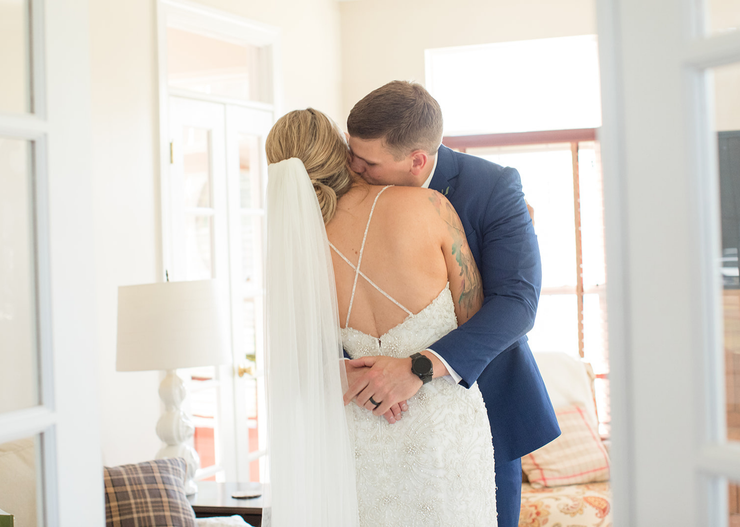 groom hugs his bride as he sees her before the wedding ceremony