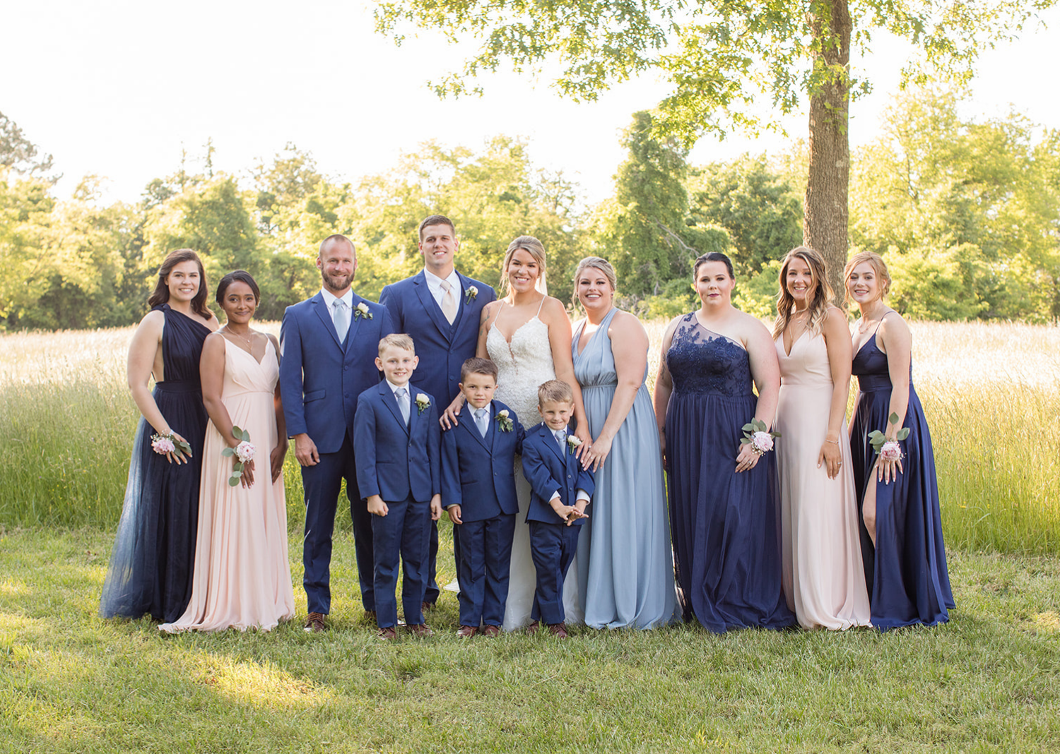 bridal party stand around the bride and groom
