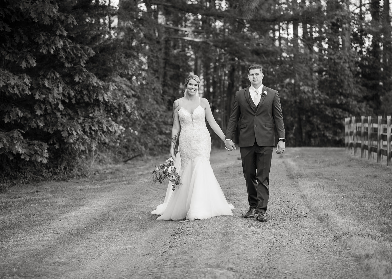 black and white photo of bride and groom outdoor portraits after wedding ceremony