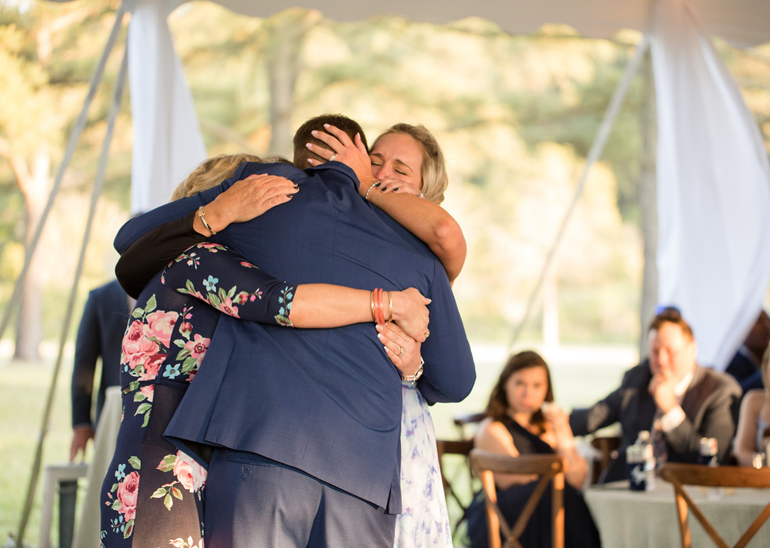 groom hugging his mother and sister