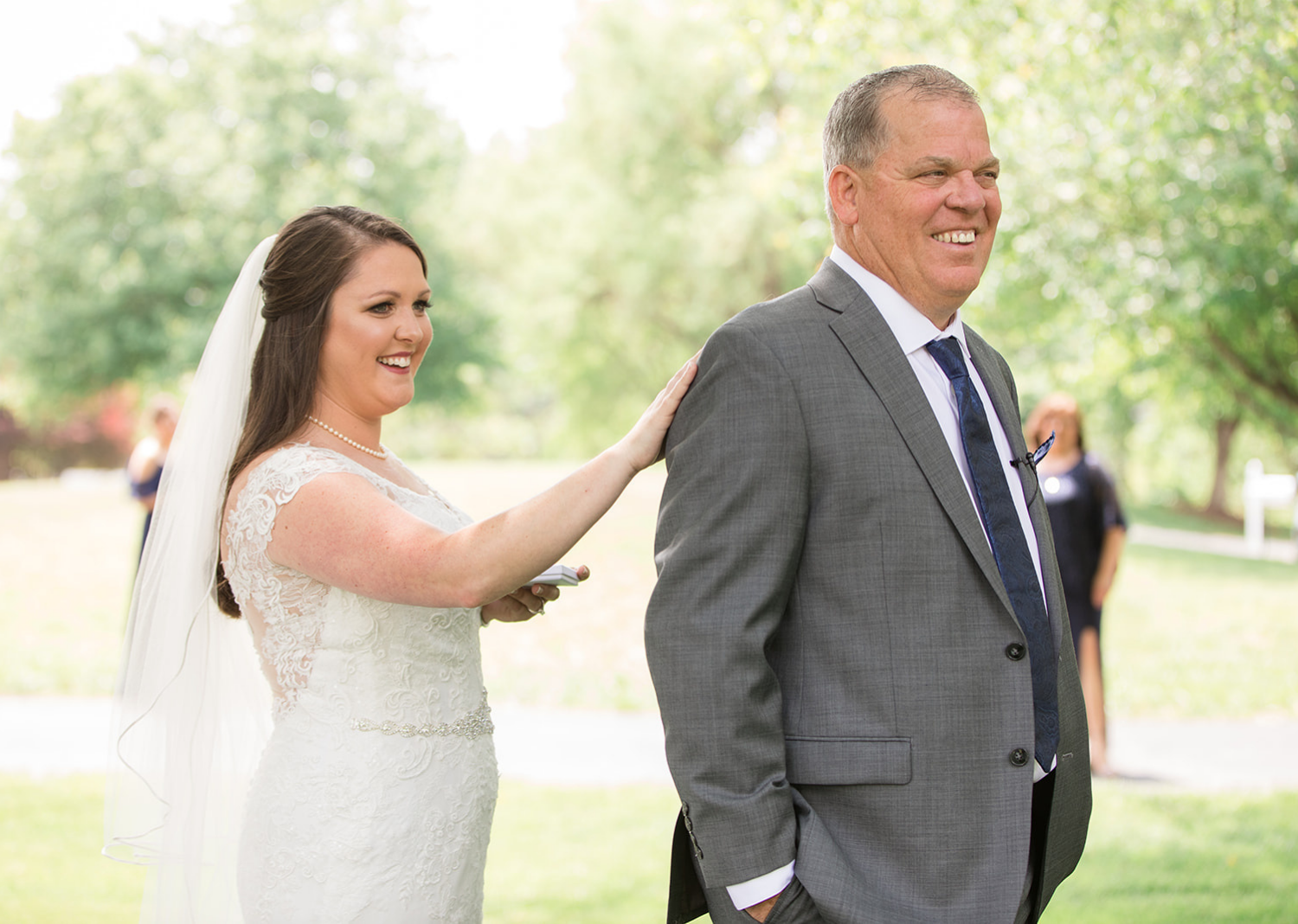 bride does first look with father of the bride