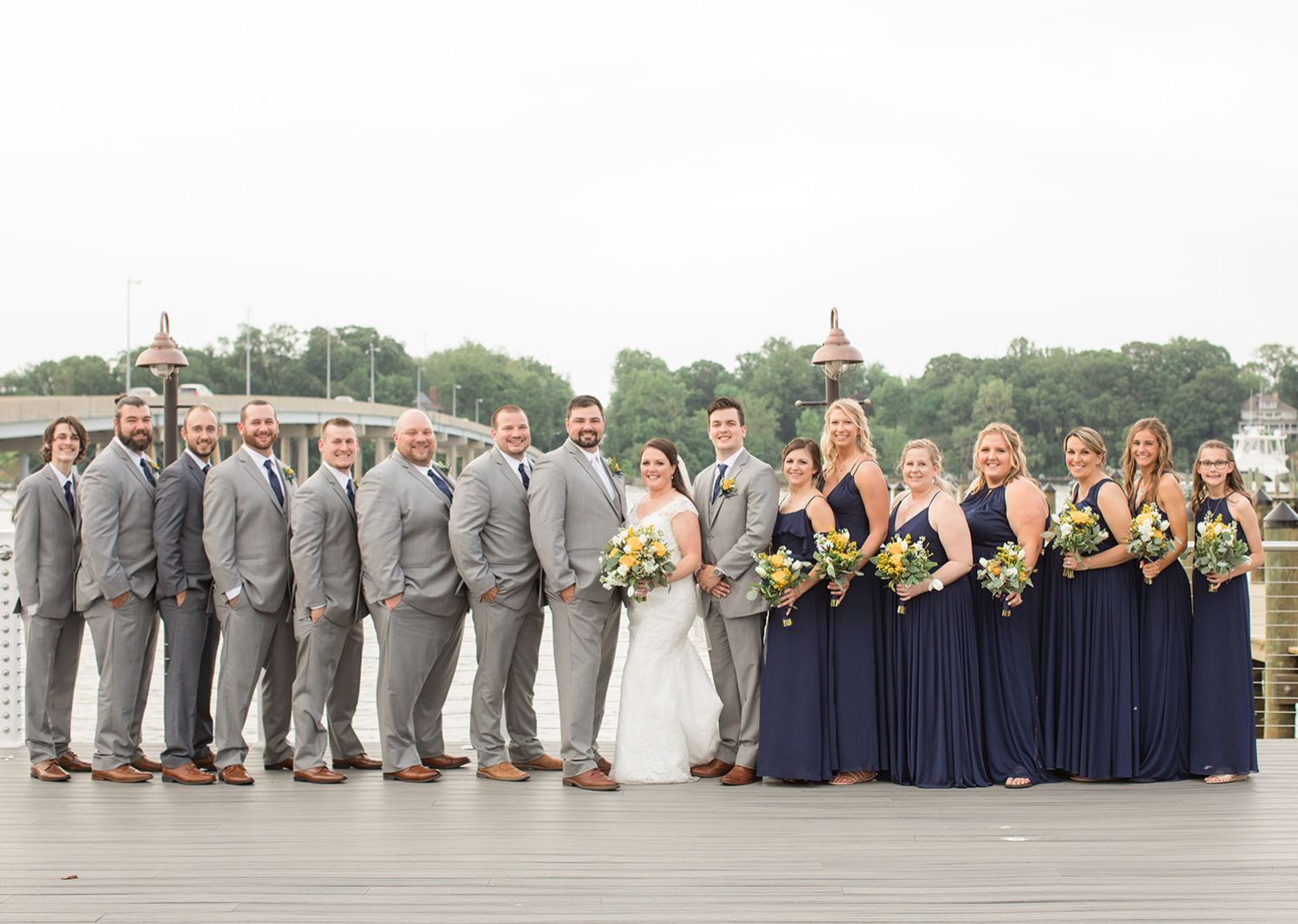 bride and groom with their wedding party