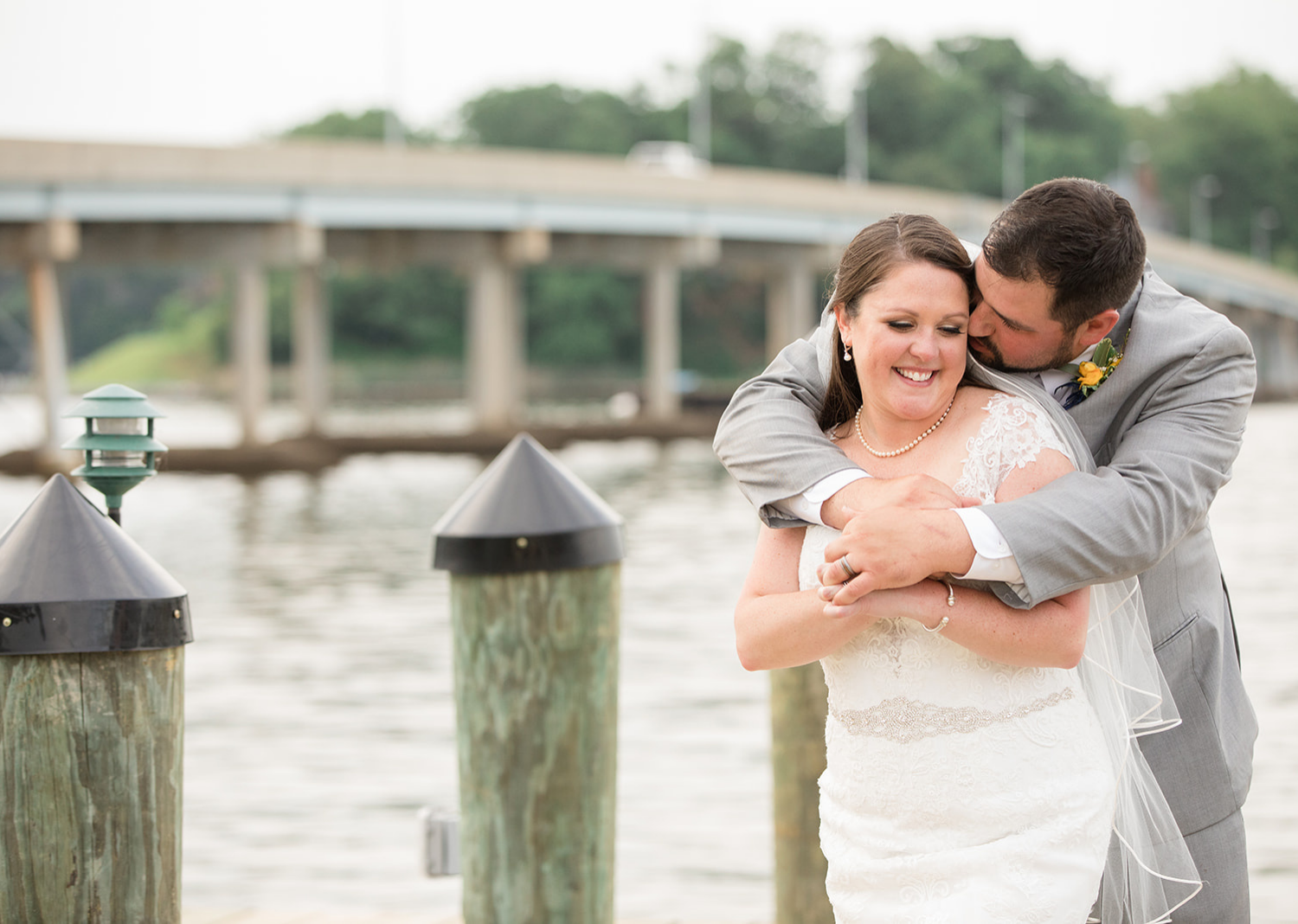 bride and groom outdoor portraits on the pier