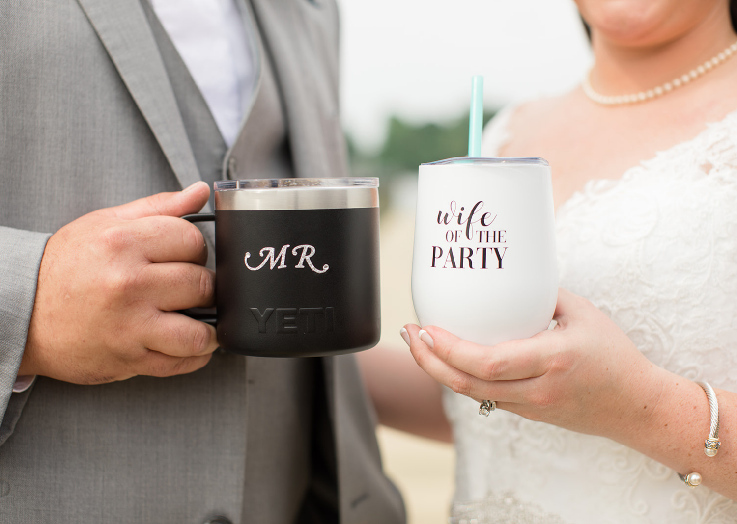 bride and groom outdoor portraits on the pier showing their personalized mugs
