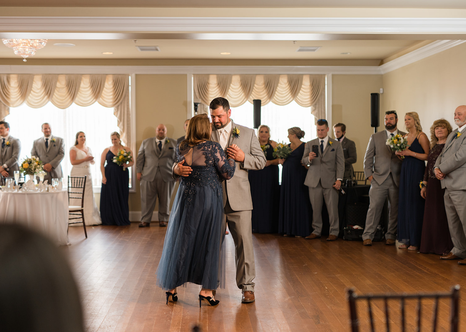groom and mother of the groom dancing