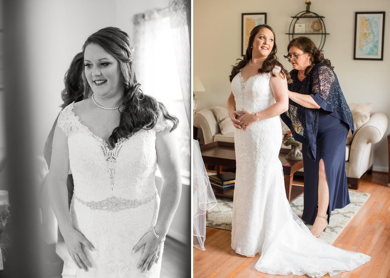 mother of the bride helps the bride zip up her wedding dress