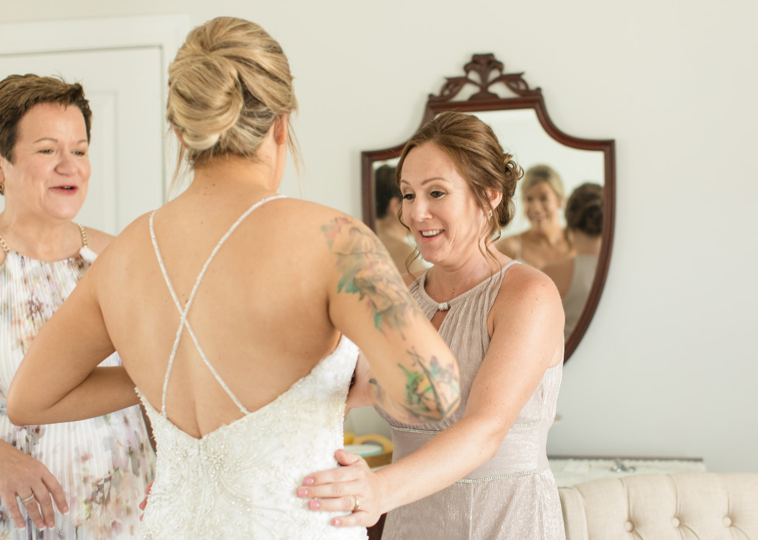 bride getting ready with the mother of the bride